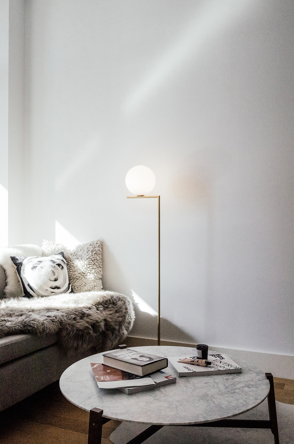 Sheepskin and FLOS Lamp from DwellStudio