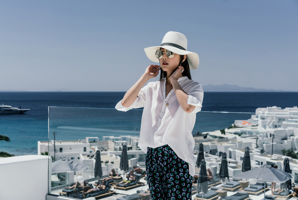 Pas de Calais Top , Stella McCartney Pants,  Vince Shoes ,  Janessa Leone Hat ,  Cutler and Gross Sunglasses ,  Cartier Necklace