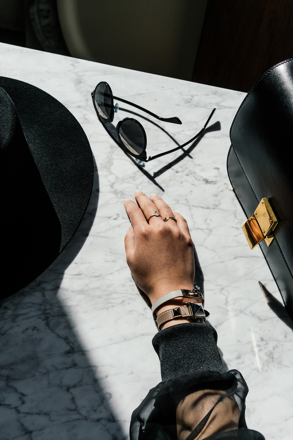Janessa Leone Hat ,  Dior Sunglasses , Céline Bag, Hermes Bracelet and Watch,  Wwake Rings