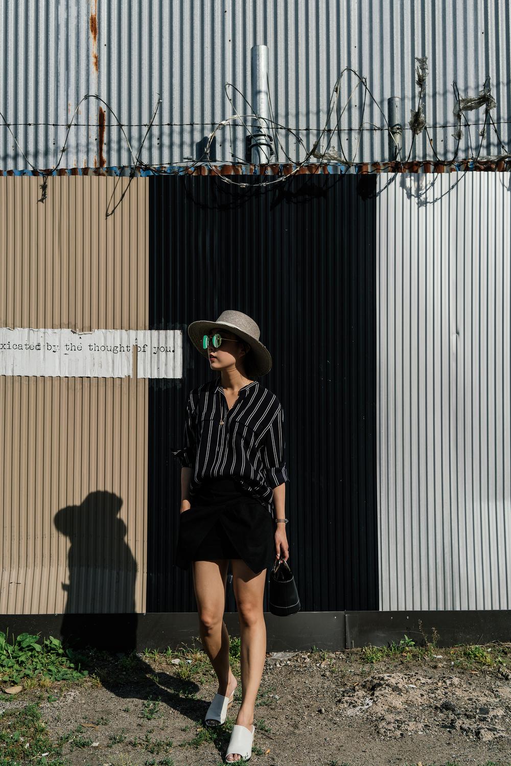 Tomorrowland Top, Isabel Marant Skirt, Dear Frances Sandals, Simon Miller Bag, Gentle Monster Sunglasses, Janessa Leone Hat