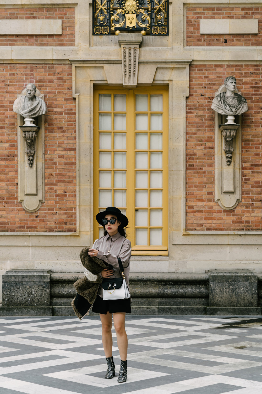 Isabel Marant Jacket, Lie Sang Bong Top, Balenciaga Skirt, Isabel Marant Boots, J.W.Anderson Bag, Janessa Leone Hat, Fendi Sunglasses, Cartier Necklace