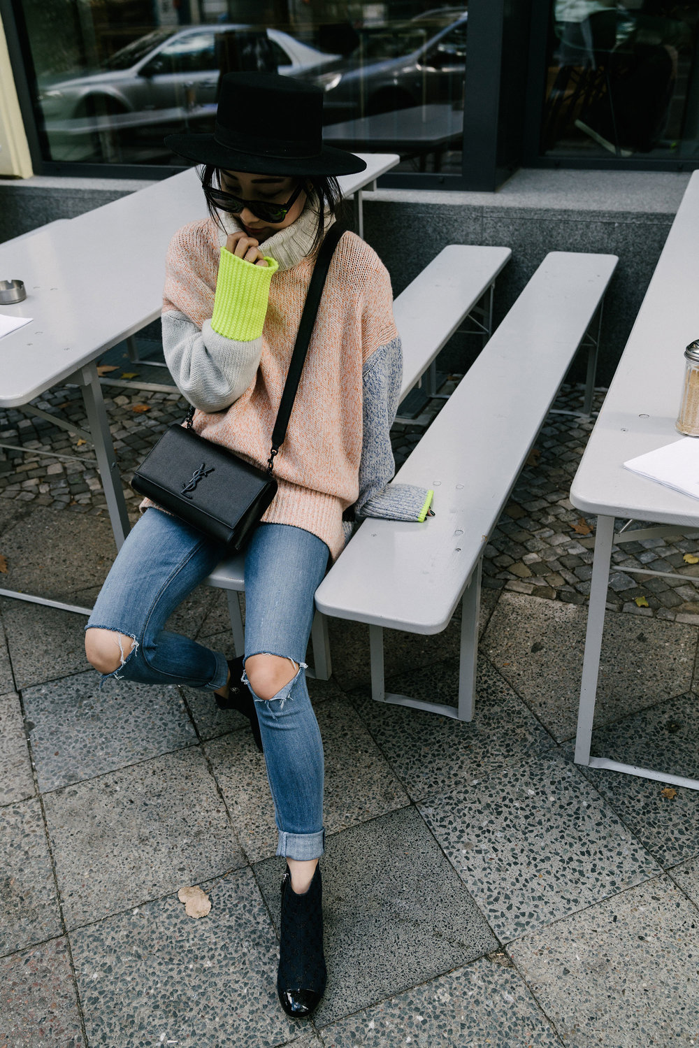 Tomorrowland Sweater ,  GRLFRND Denim , Chanel Shoes,  Saint Laurent Bag ,  Janessa Leone Hat , Céline Sunglasses