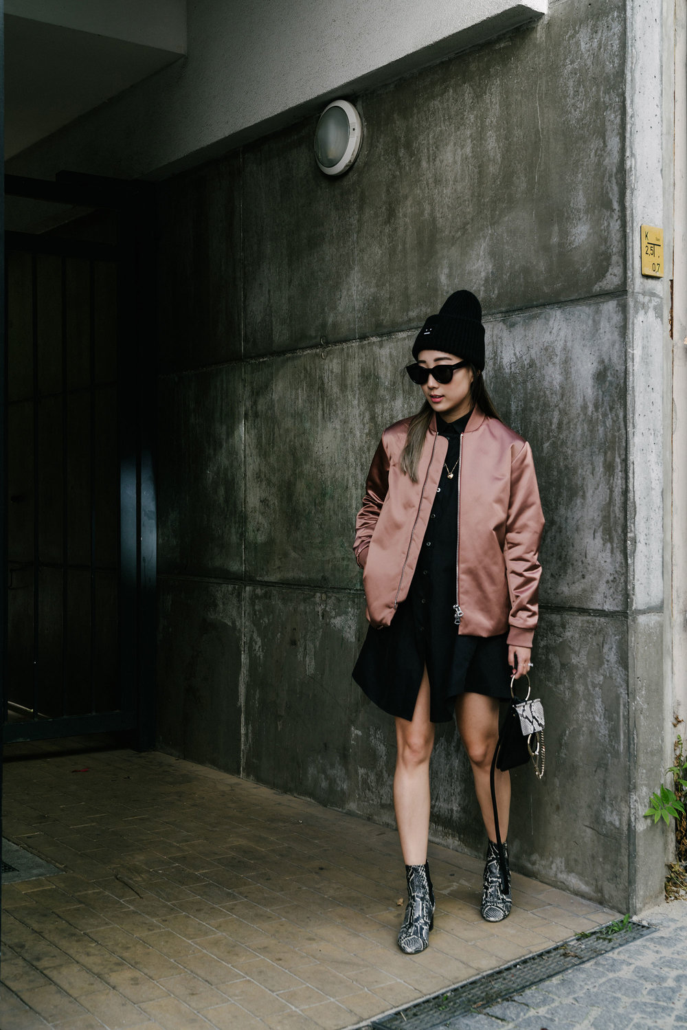 Acne Studios Jacket,  Jourden Dress ,  Chloé Bag ,  Isabel Marant Shoes ,  Acne Studios Beanie , Céline Sunglasses,  Cartier Necklace