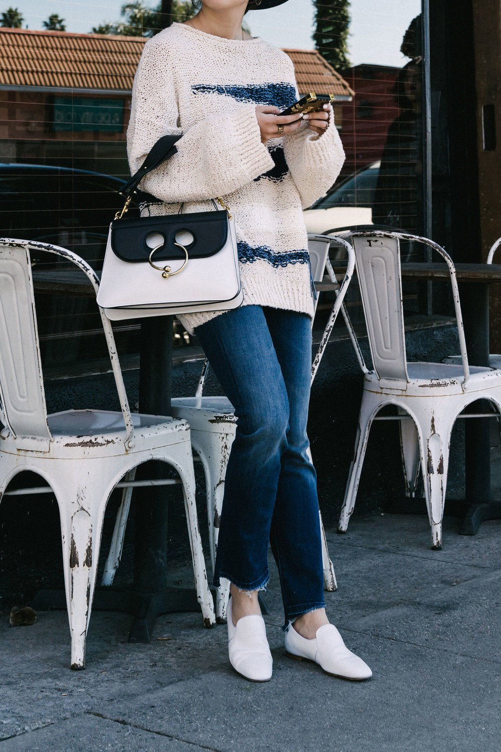 Tomorrowland Sweater ,  Mother Denim ,  The Row Shoes ,  J.W. Anderson Bag , Louis Vuitton Phone Case