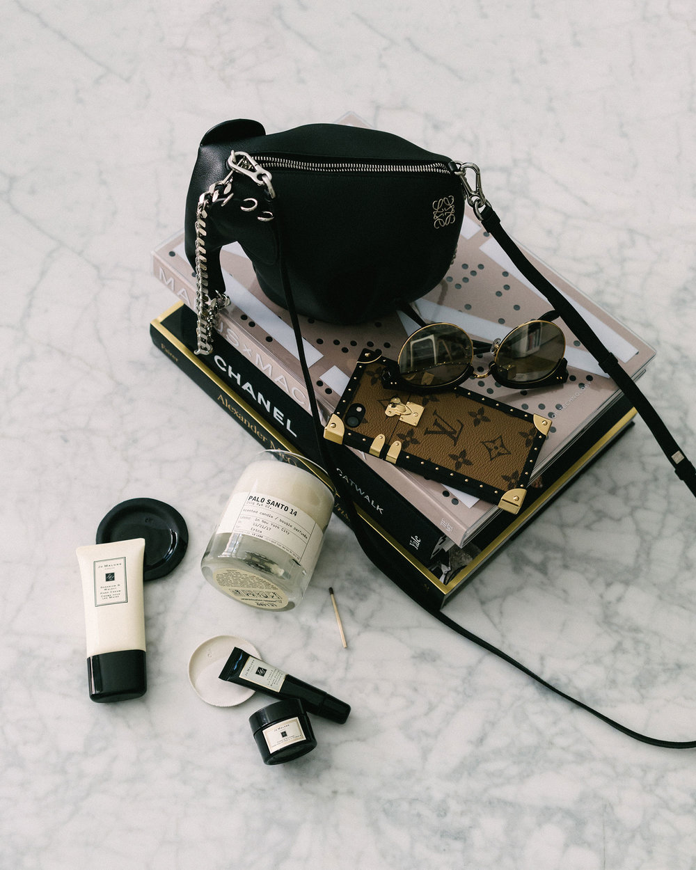 Loewe Bag, Louis Vuitton iPhone Case, Le Labo Candle, Jo Malone Hand Cream, Eye Cream, Lip Balm