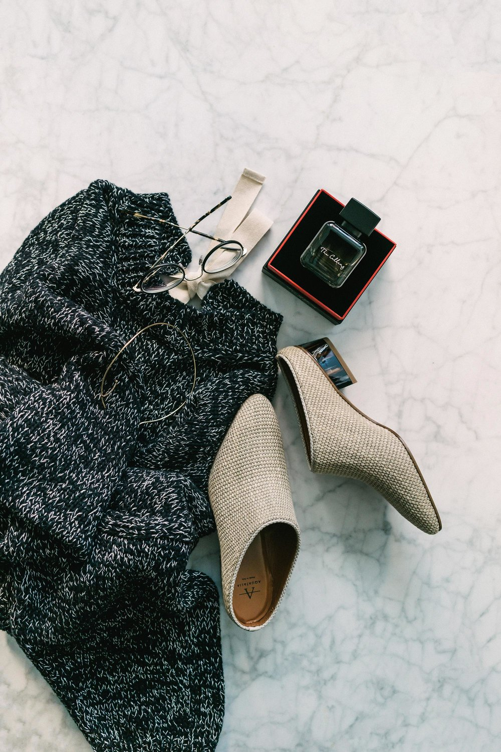 J.W. Anderson Sweater,  Aquatalia Shoes ,  Garrett Leight x Want Les Essentiels Glasses ,  Phuong Dang Fragrance ,  Kat Kim Fine Jewelry Choker