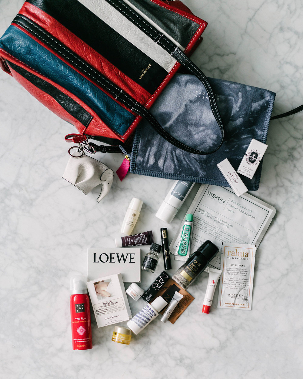 Balenciaga Bag, Loewe Keychain, Barneys New York Love Yourself Beauty Bag (ends tomorrow, March 11th!)