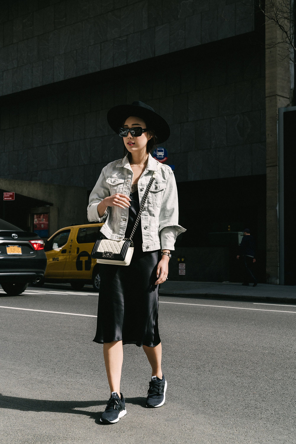 Uniqlo Jacket ,  Maison Margiela Dress ,  New Balance Sneakers , Chanel Bag, Chloé Sunglasses,  Janessa Leone Hat