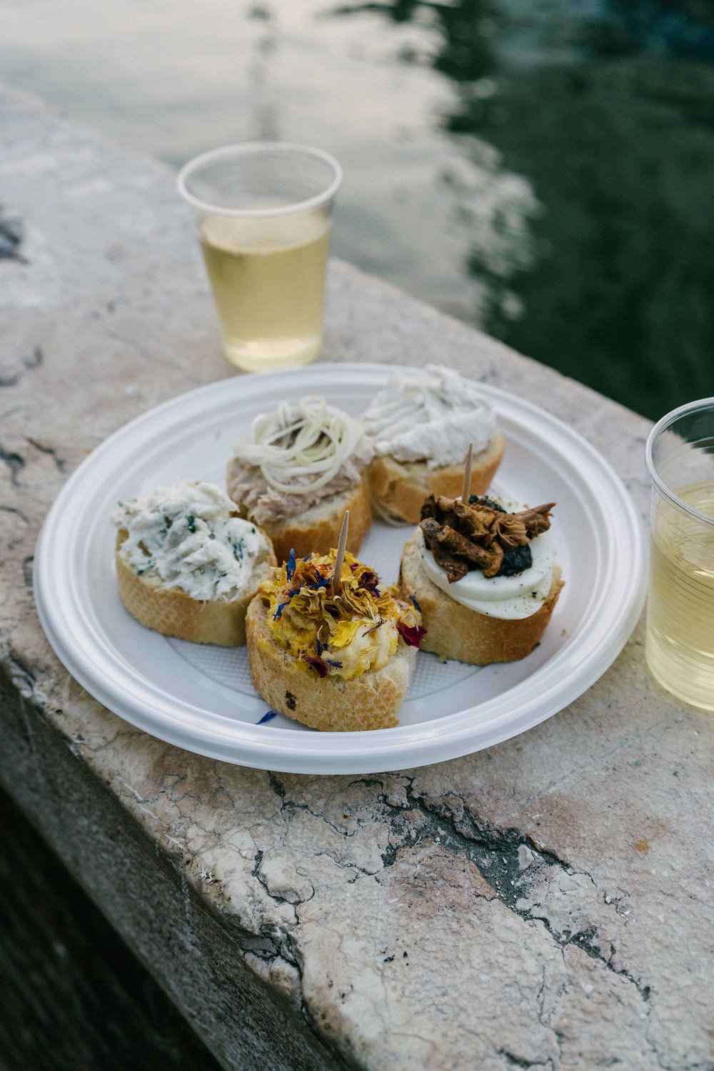 Cicchetti (Venetian small snacks) and wine outside by the canal