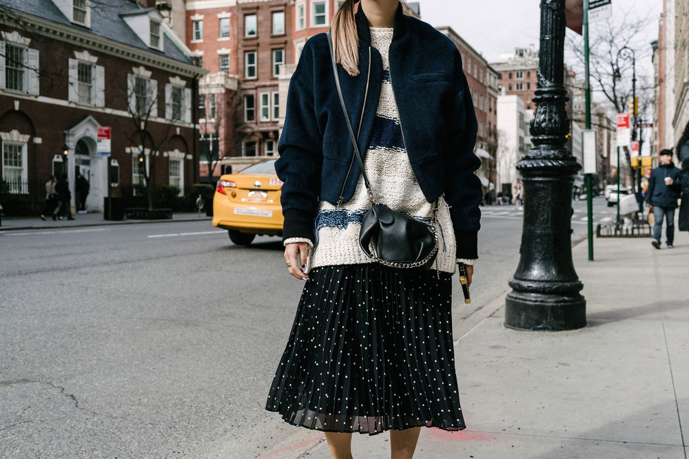 Cienne NY Jacket ,  Tomorrowland Sweater ,  Sézane Skirt ,  The Row Shoes ,  Loewe Bag ,  Louis Vuitton Case , COS Beanie