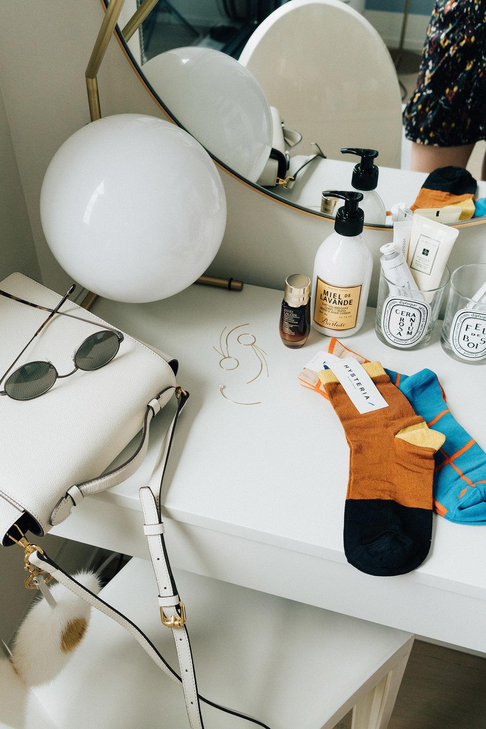 Milma Bag ,  Oliver Peoples x The Row Sunglasses ,  Hirotaka Earrings ,  Happy Socks Hysteria Socks ,  Estée Lader Serum ,  Bastide Lotion