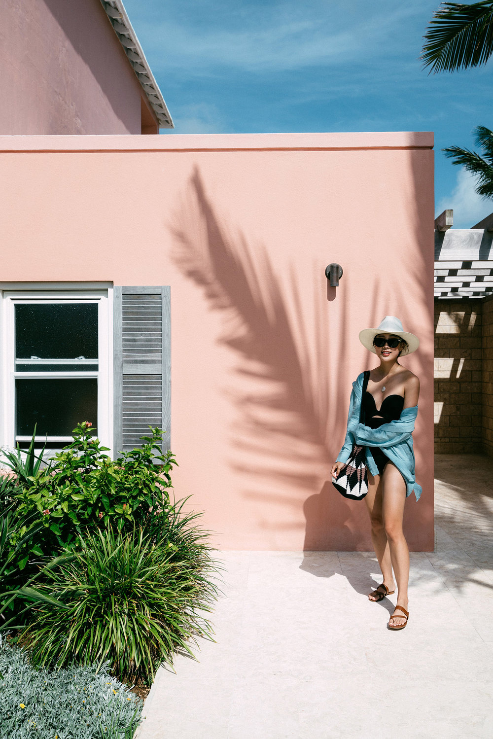 COS Top ,  Proenza Schouler Swimsuit ,  Manolo Blahnik Sandals ,  Sophie Anderson Bag ,  Janessa Leone Hat , Céline Sunglasses