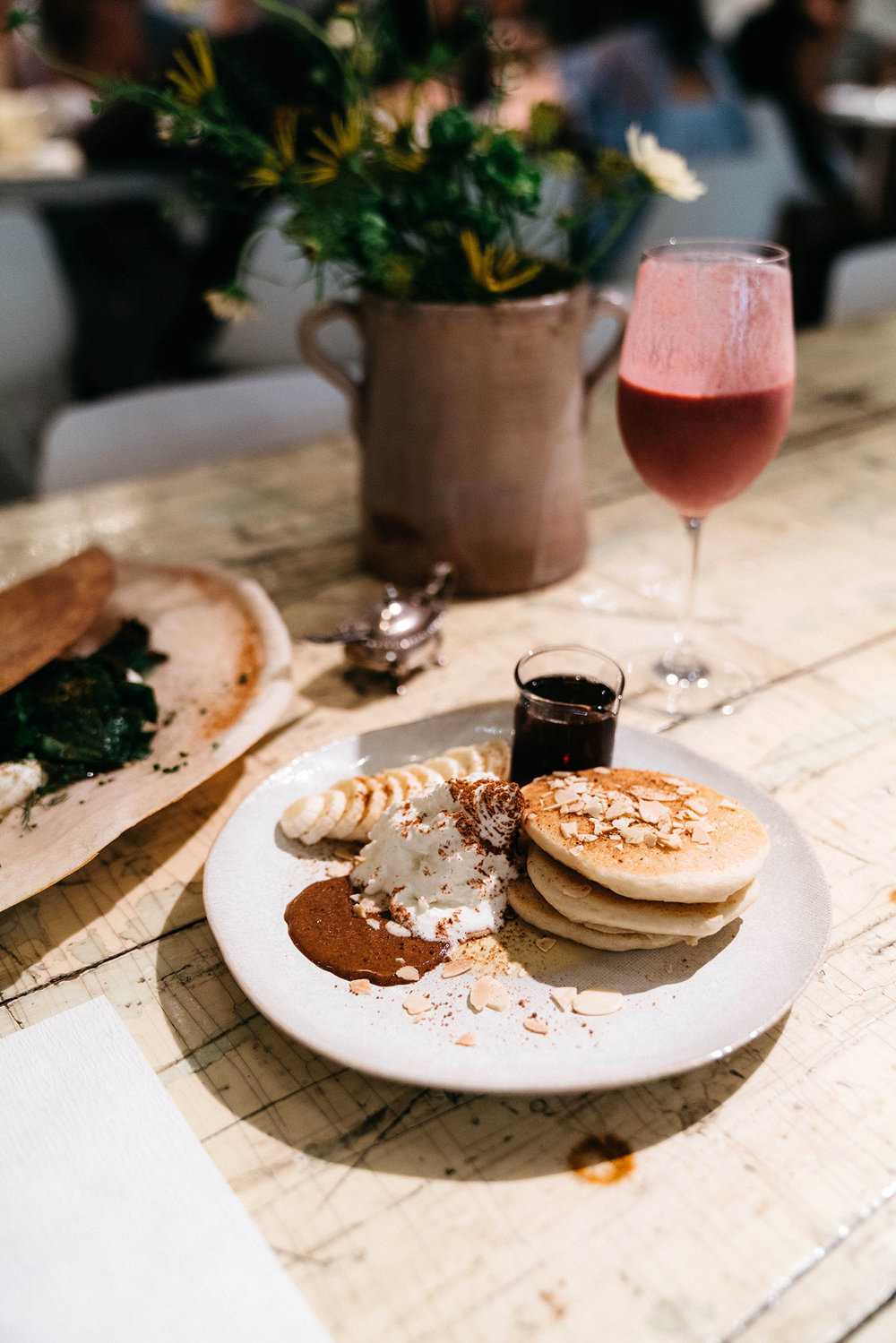 Egg dosa, gluten-free almond pancakes, and berry yogurt smoothie at abcV
