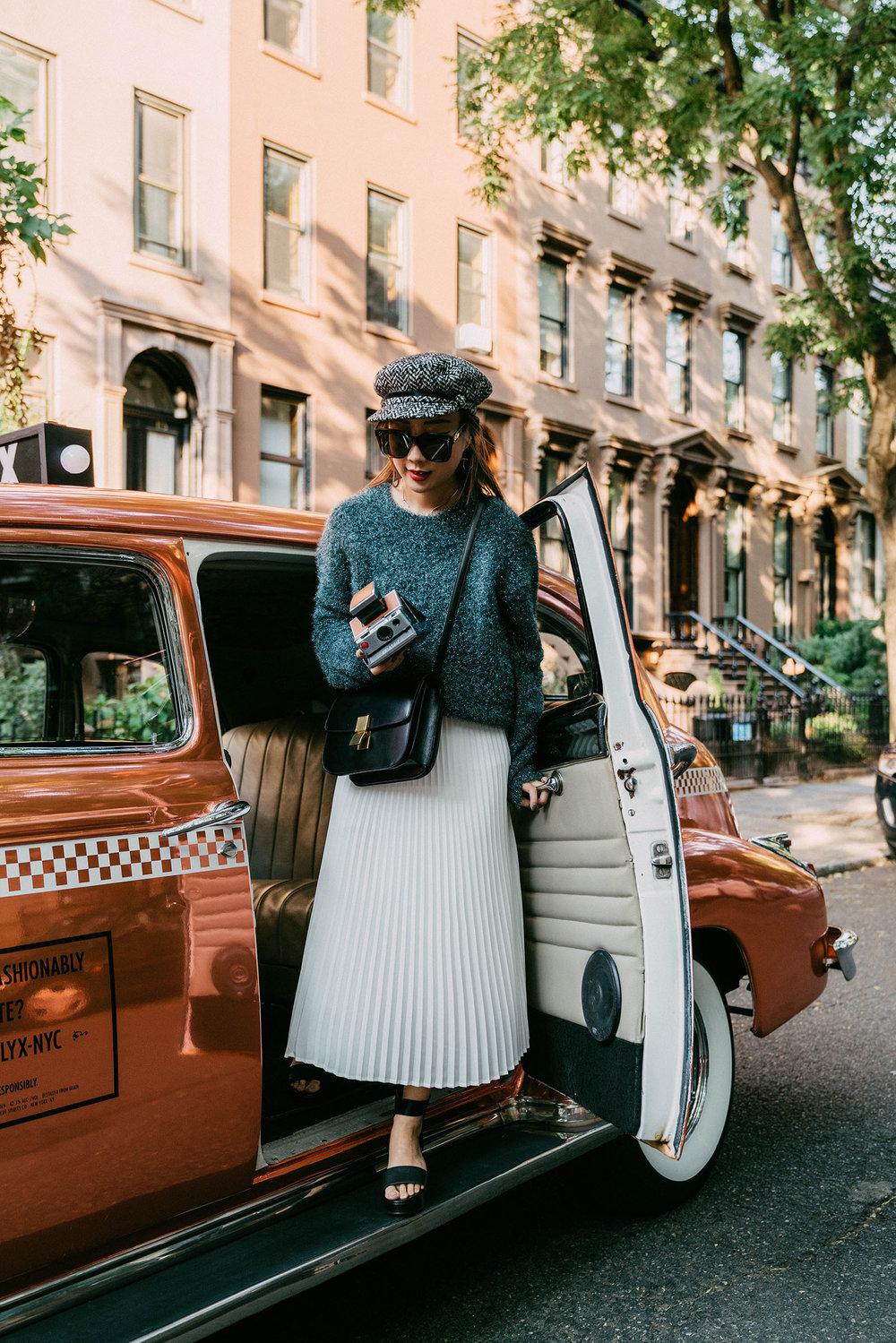 Sies Marjan Sweater  ( Similar ),  Aritzia Skirt ,  Seven All Around Sandals ,  Eugenia Kim Hat , Céline Bag