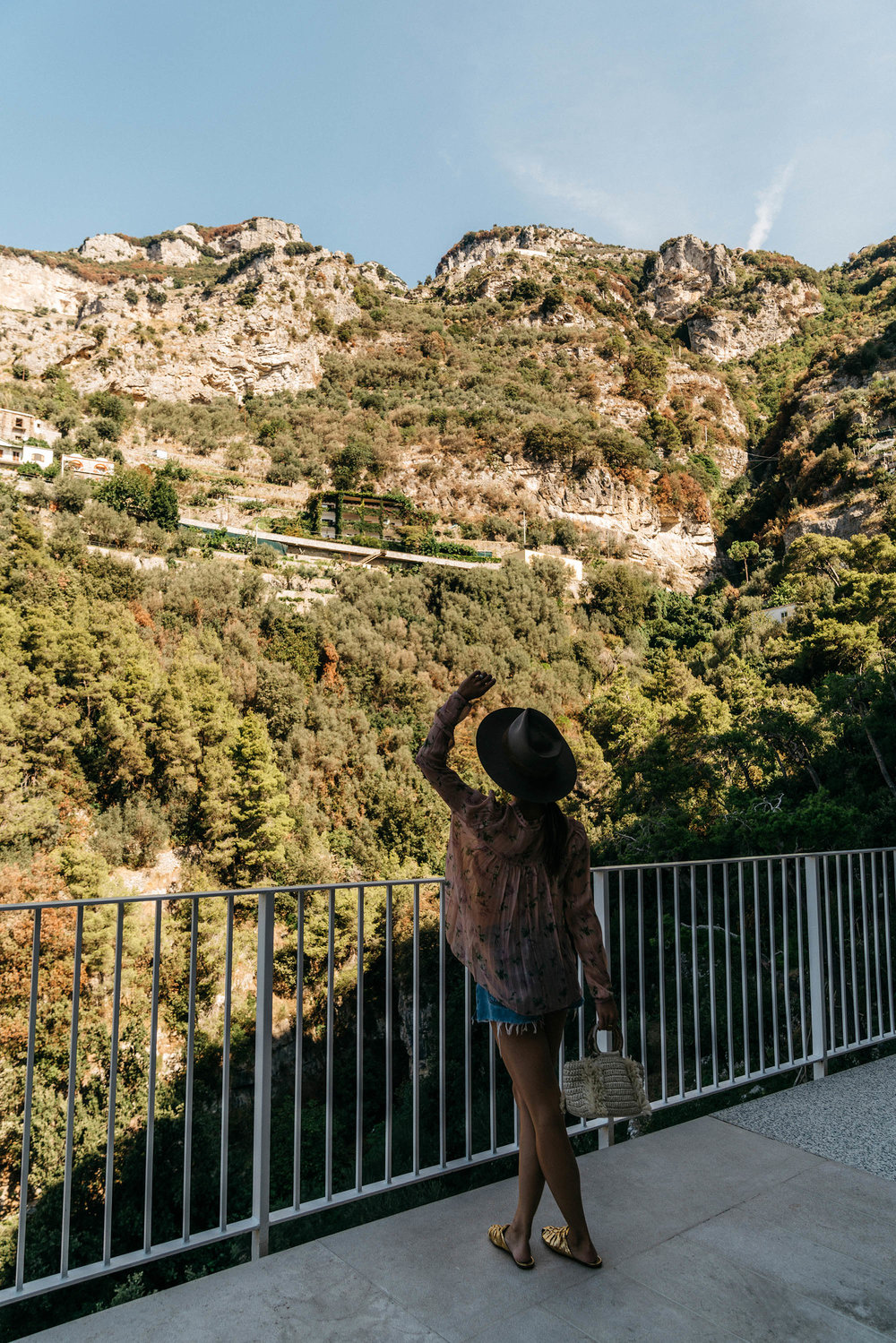 Ulla Johnson Top , RE/DONE Shorts,  The Row Slides ,  Caroline Santo Domingo Bag