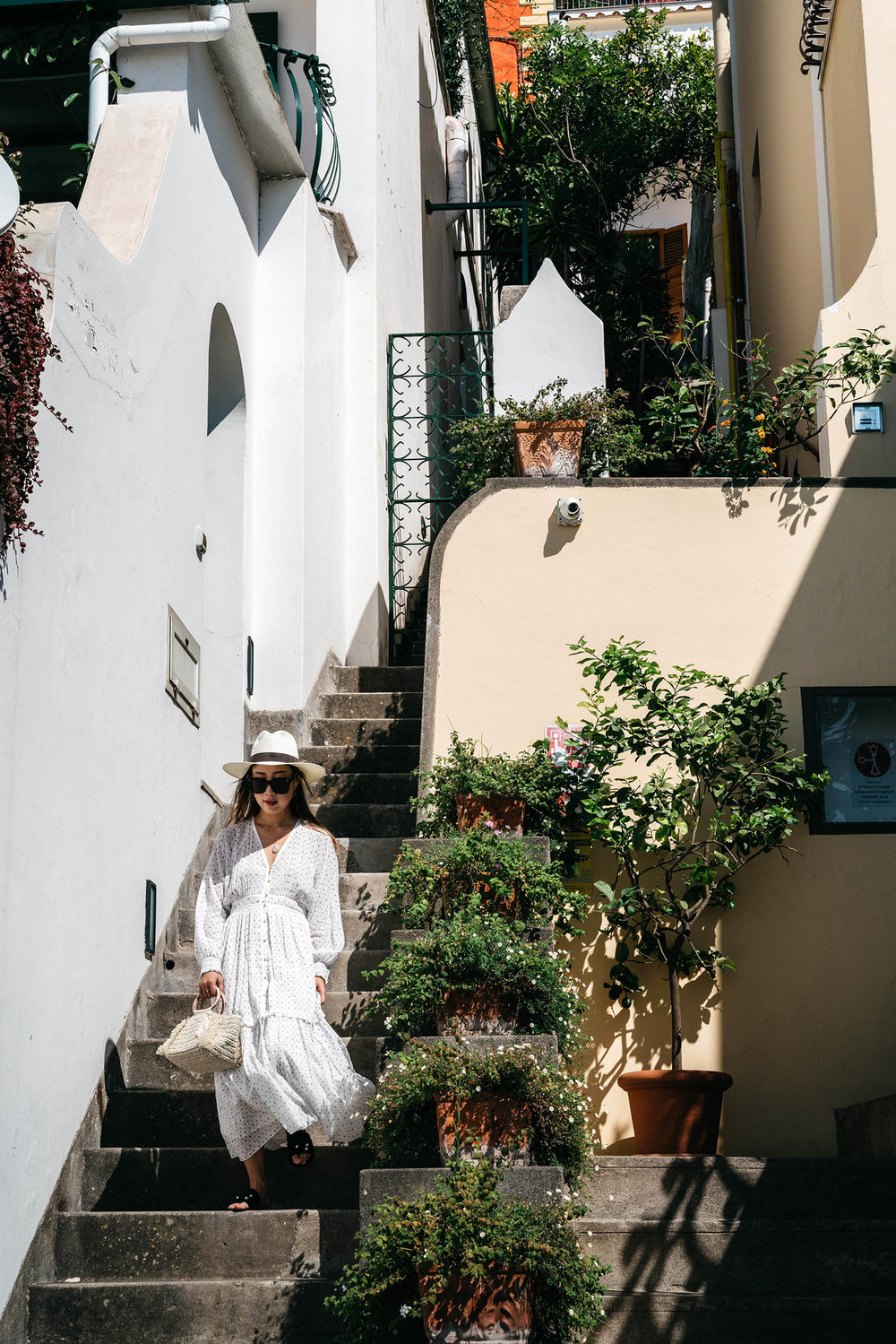 Ulla Johnson Dress ,  Carolina Santo Domingo Bag ,  Dear Frances Sandals ,  Janessa Leone Hat ,  CVC Stones Necklace