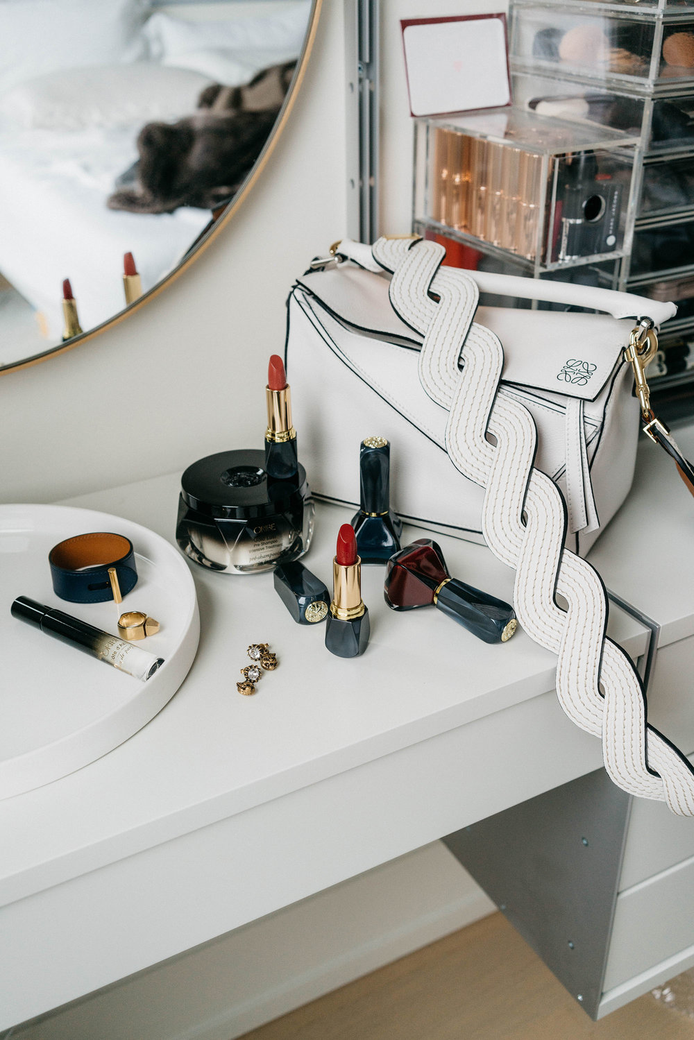 Hermes Bracelet, Saint Laurent Ring, Gucci Earrings, Oribe Beauty, Loewe Bag