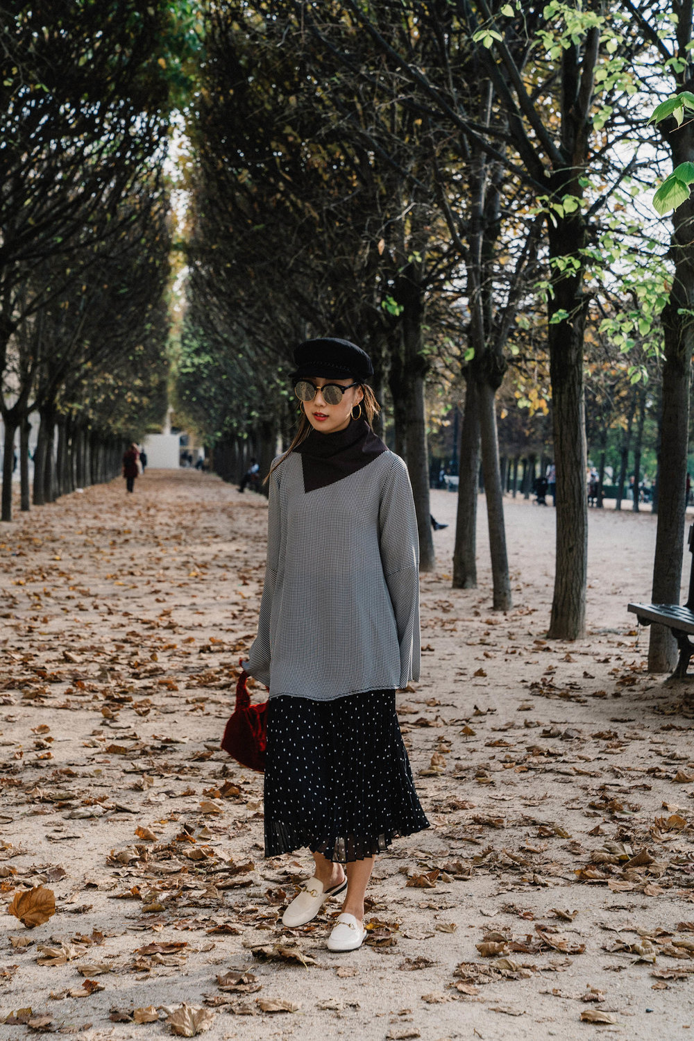 Acne Studios Top ,  Sezane Skirt ,  Gucci Shoes ,  The Row Bag ,  Gucci Scarf , Eugenia Kim Hat,  Gentle Monster Sunnies