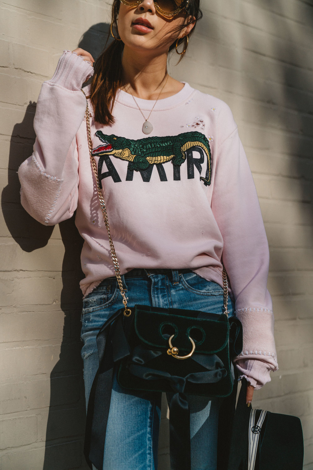 Amiri Sweatshirt, Moussy Denim, J.W. Anderson Bag