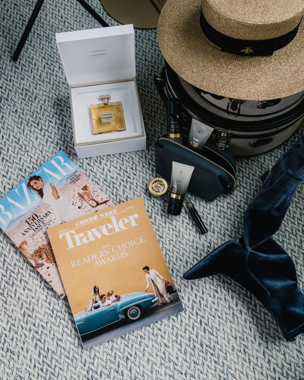 Chanel Parfum, Oribe Travel Kit, Gucci Hat, Prada Boots
