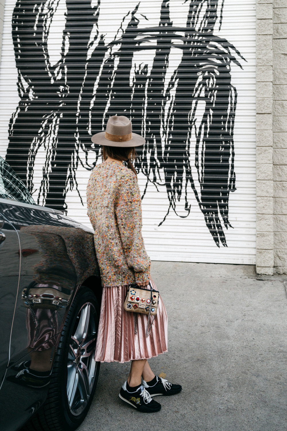 Chloé Sweater, Petite Studio Skirt,  Kenzo Sneakers , Fendi Bag, Janessa Leone Hat