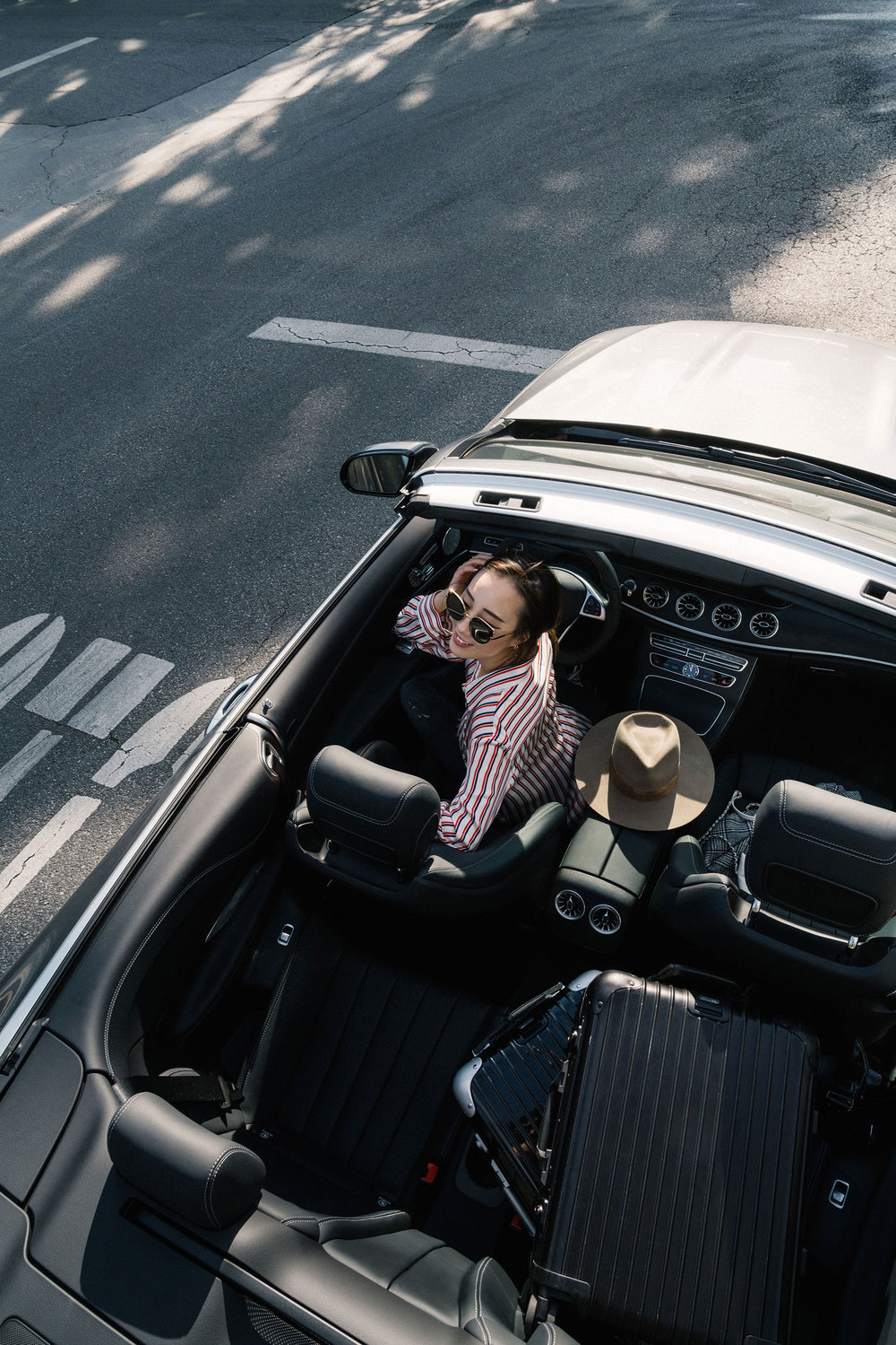 Wearing an  Asceno top  in an  E400 Cabriolet  before heading to the airport!
