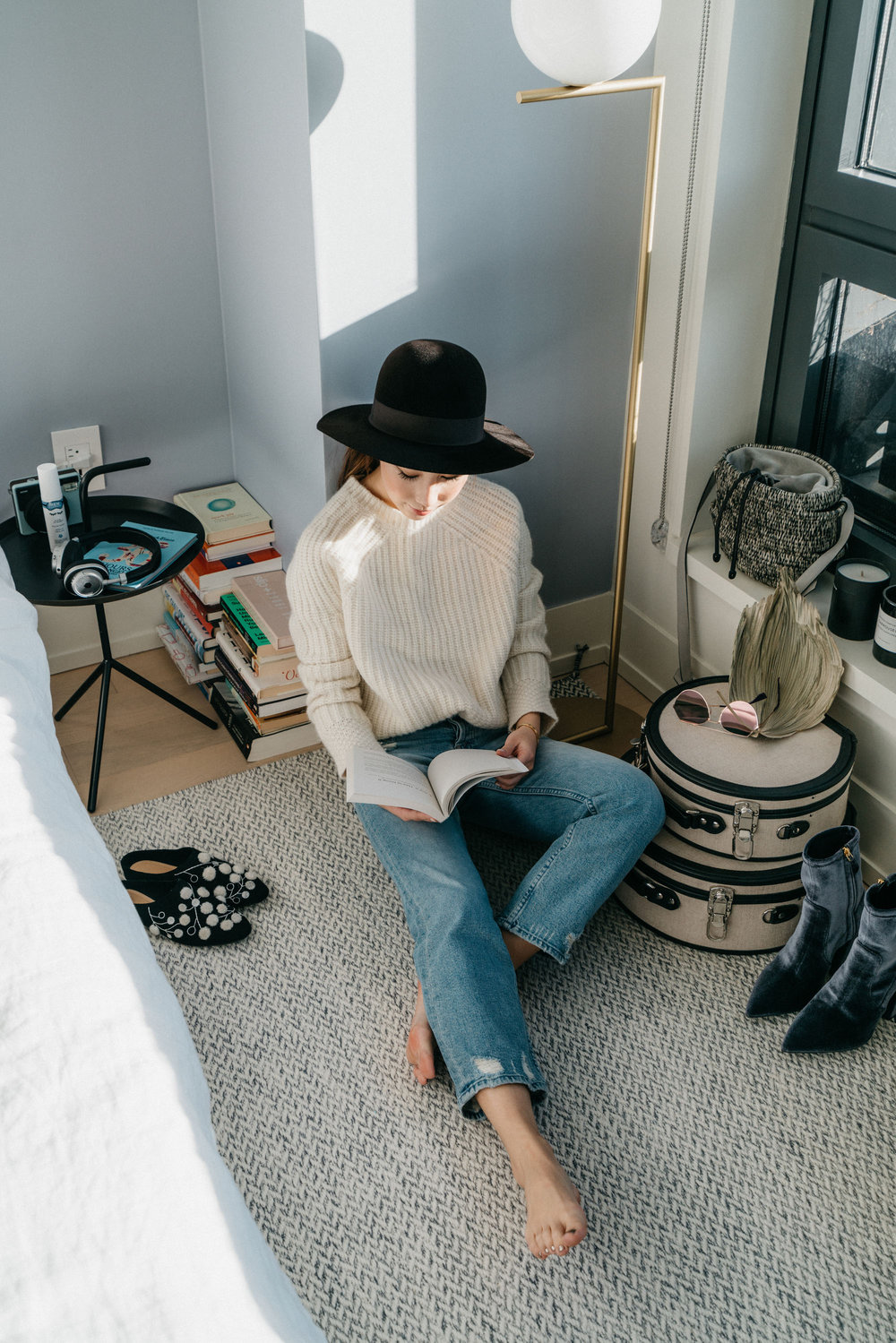 The Row Slippers , Nili Lotan Sweater,  Mother Denim , Saint Laurent Hat,  Fendi Sunglasses ,  Steamline Luggage , Prada Boots