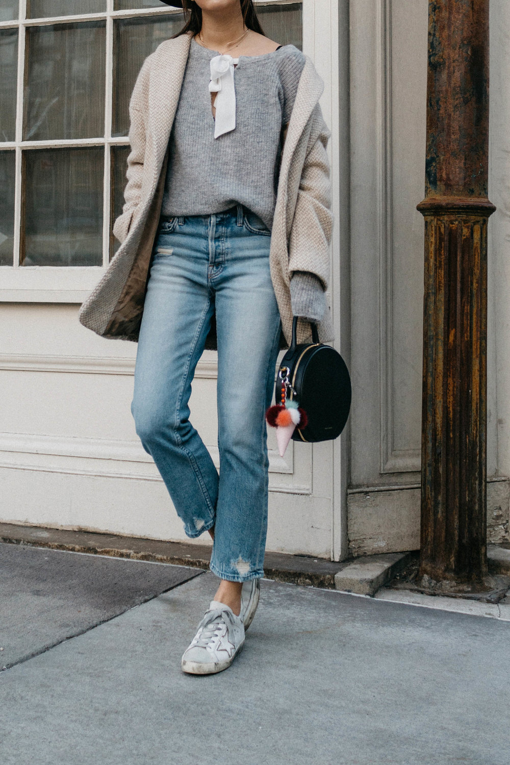 Sézane Coat , Sézane Sweater, Mother Denim,  Golden Goose Sneakers ,  Mansur Gavriel Bag ,  Fendi Keychain ,  Kat Kim Choker ,  Wwake Necklace