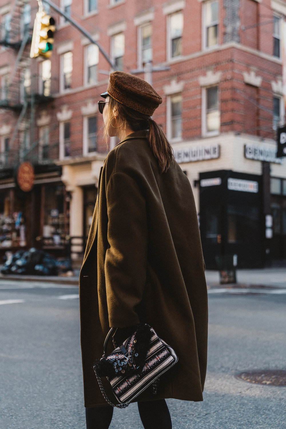 Isabel Marant Coat,  Sézane Sweater ,  & Other Stories Skirt , Fendi Boots,  Saint Laurent Bag ,  Ruslan Baginskiy Hat