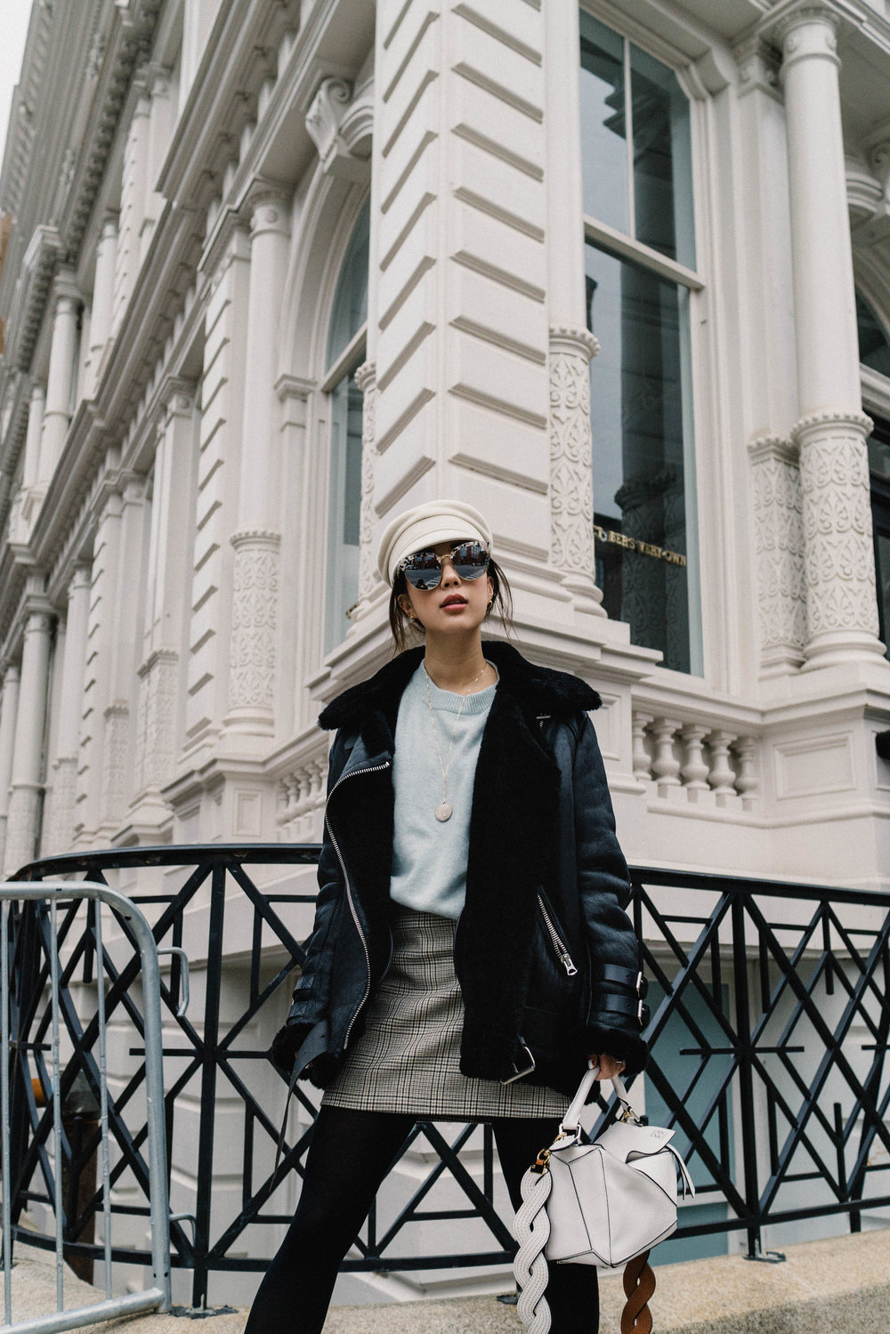 Acne Studios Coat ,  COS Sweater , Reformation Skirt, Dear Frances Boots,  Loewe Bag ,  Gentle Monster Sunglasses ,  Ruslan Baginskiy Hat