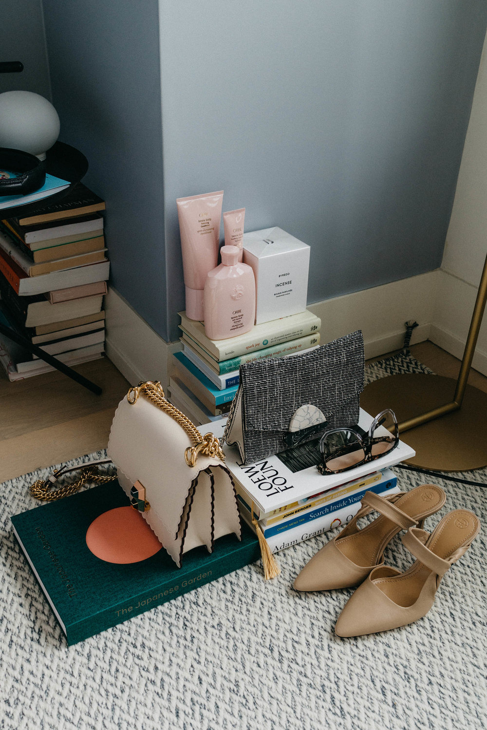 Oribe Haircare ,  Byredo Candle ,  Proenza Schouler Bag , Loewe Sunglasses,  Fendi Bag ,  The Row Shoes ,  The Japanese Garden Book