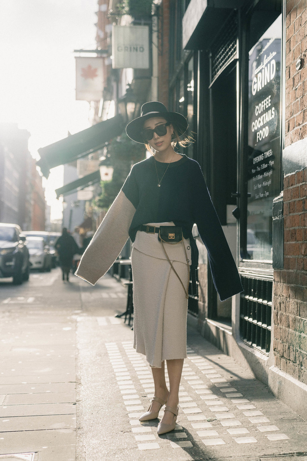 Yune Ho Sweater ,  COS Skirt ,  The Row Shoes ,  Givenchy Bag ,  Cartier Necklace , Celine Sunglasses, Maison Michel Hat