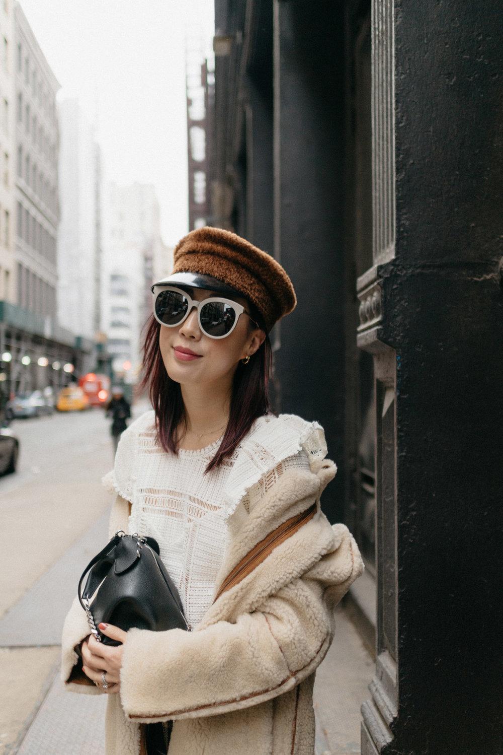 Madewell Jacket,  Sezane Top , The Reformation Skirt,  Loewe Bag ,  Ruslan Baginskiy Hat , Gentle Monster Sunglasses