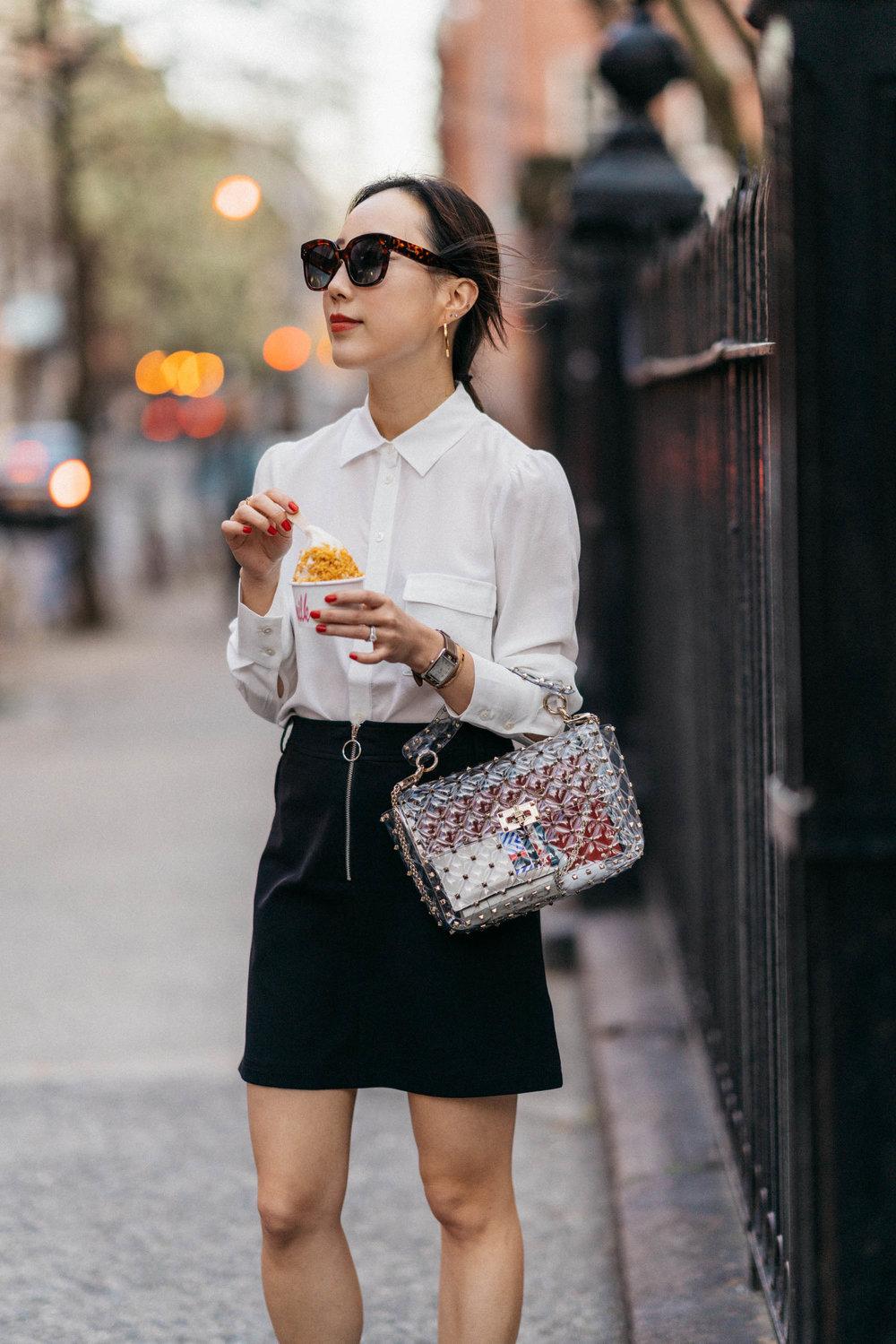 Eating Cereal Milk Soft Serve from  Milk Bar   Wearing  Petite Studio Shirt ,  Petite Studio Skirt ,  Valentino Bag ,  Céline Sunglasses
