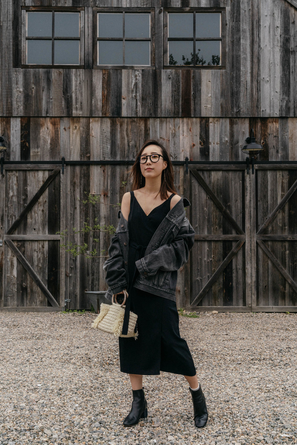 Balenciaga Jacket,  Everlane Dress , The Row Boots,  Carolina Santo Domingo Bag ,  Tom Ford Glasses , Wwake Earrings