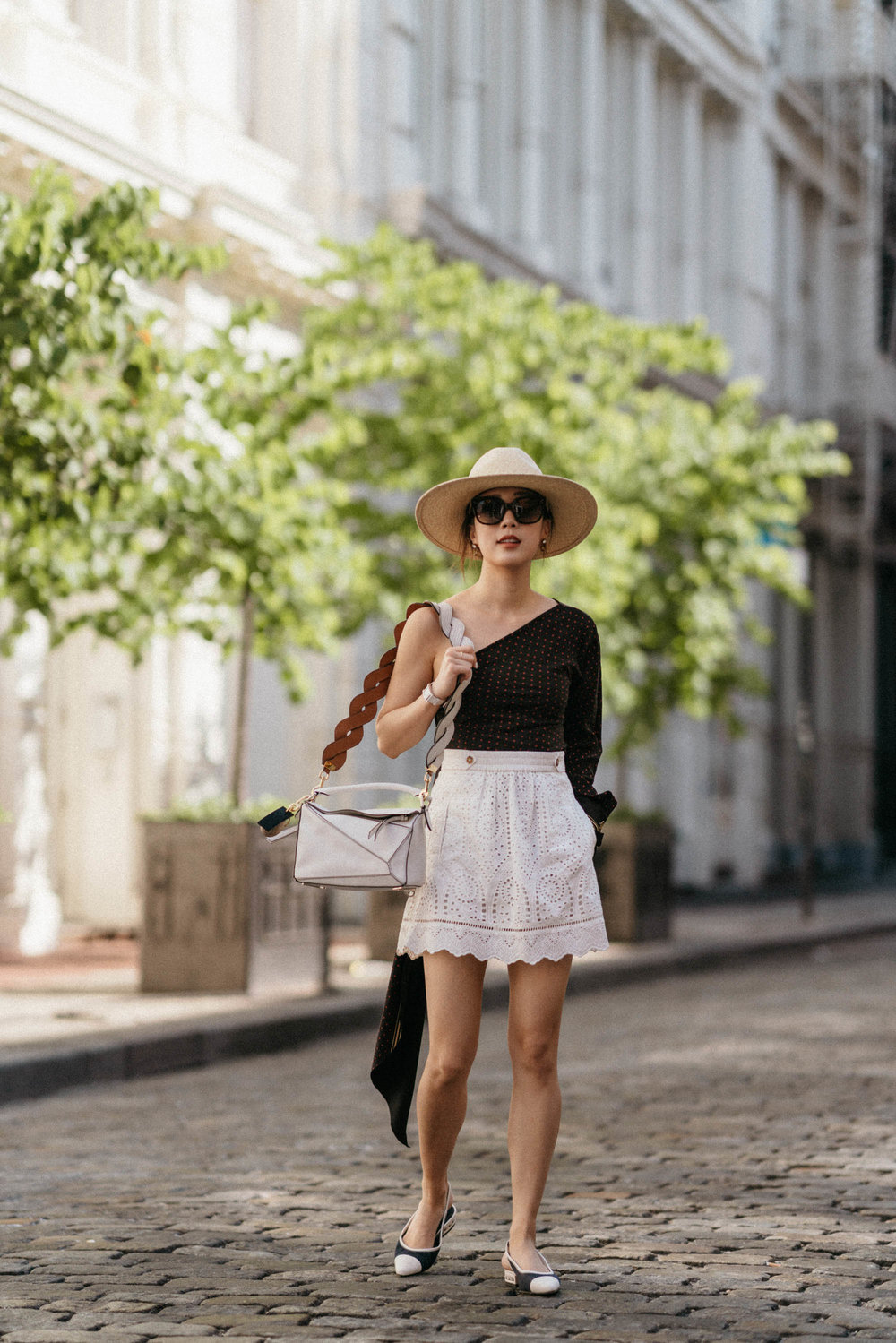 Philosophy   di Lorenzo Serafini Top ,  Sezane Skirt , Chanel Shoes,  Loewe Bag ,  Janessa Leone Hat ,  Celine Sunglasses