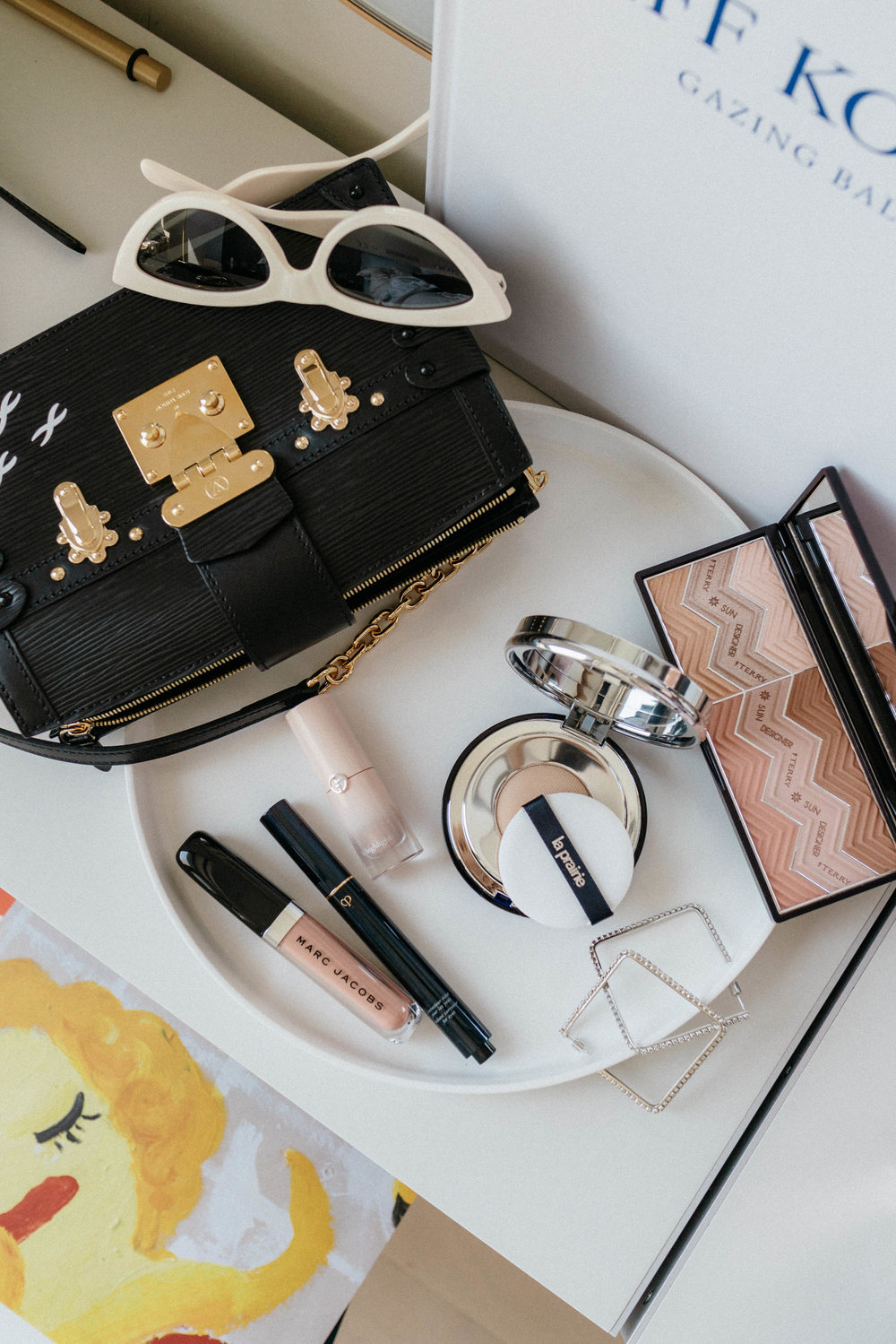 By Terry Palette ,  La Prairie Cushion Compact ,  Armani Beauty Highlighter ,  Clé de Peau Beauté Concealer ,  Marc Jacobs Lipstick ,  AREA Earrings ,  Céline Sunglasses