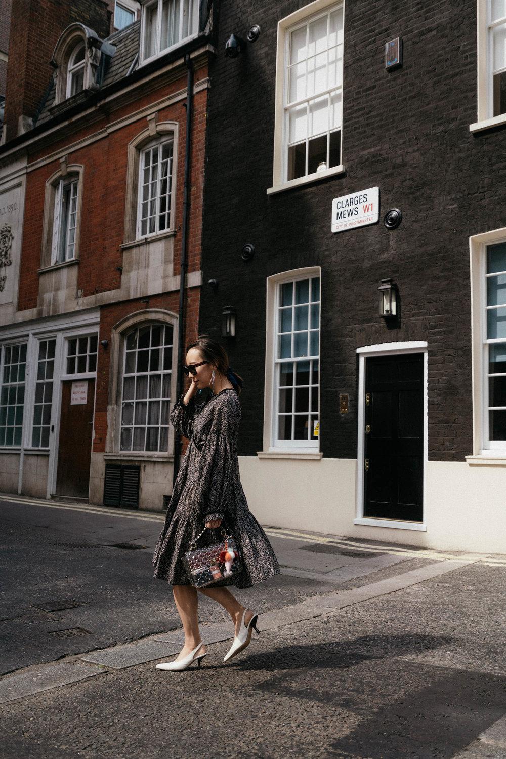 Doen Dress ,  The Row Shoes ,  Valentino Bag , Fendi Keychain,  Celine Sunglasses ,  Area Earrings