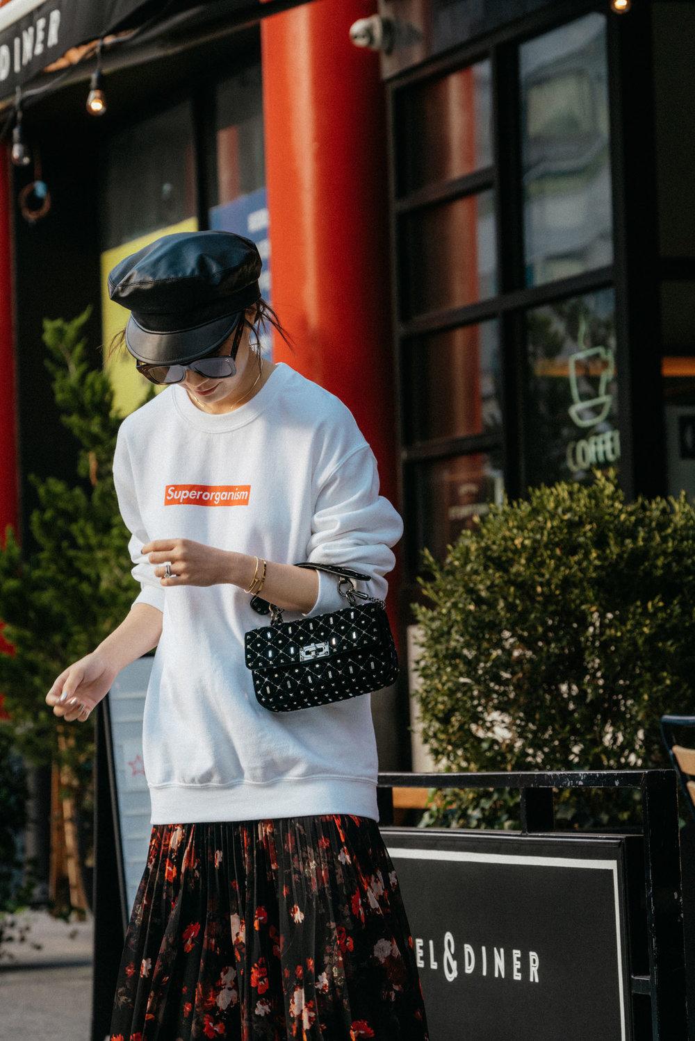 Aritzia Skirt,  Valentino Bag , Eric Javits Hat, Céline Sunglasses