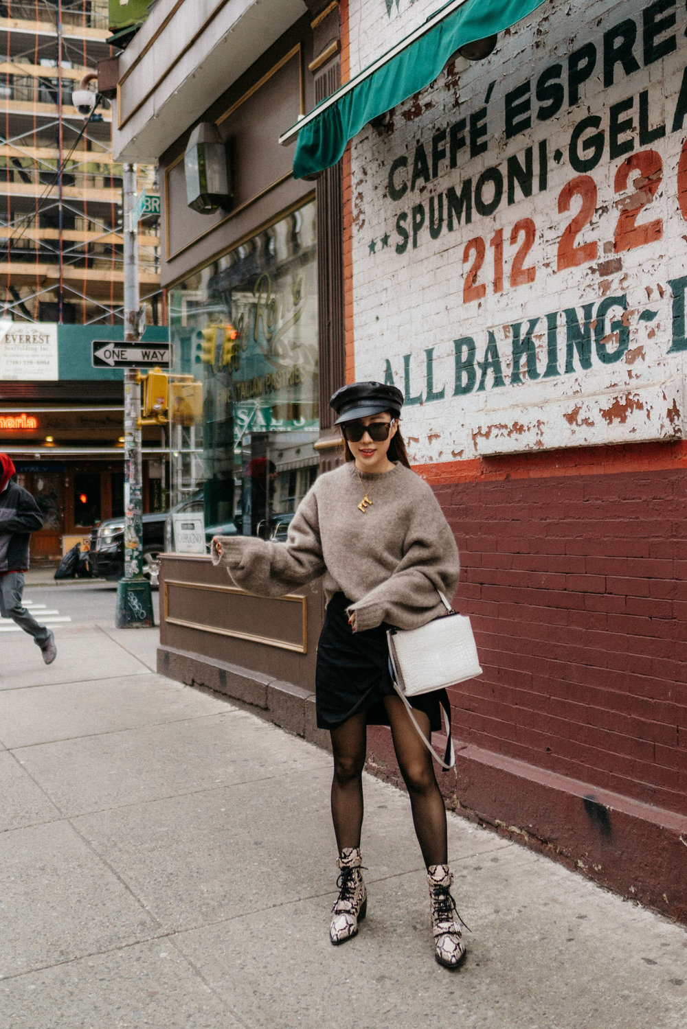 Inexclsv Sweater , Helmut Lang Skirt, Kuho Bag,  Wolford Tights ,  Chloé Boots , Eric Javits Hat, Céline Necklace