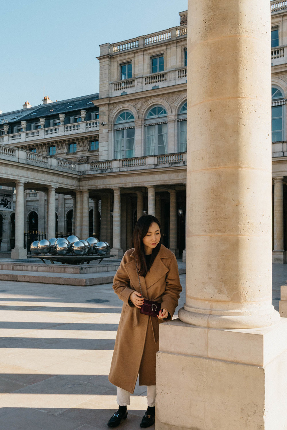 Julie  is wearing Max Mara Coat and Gucci Bag