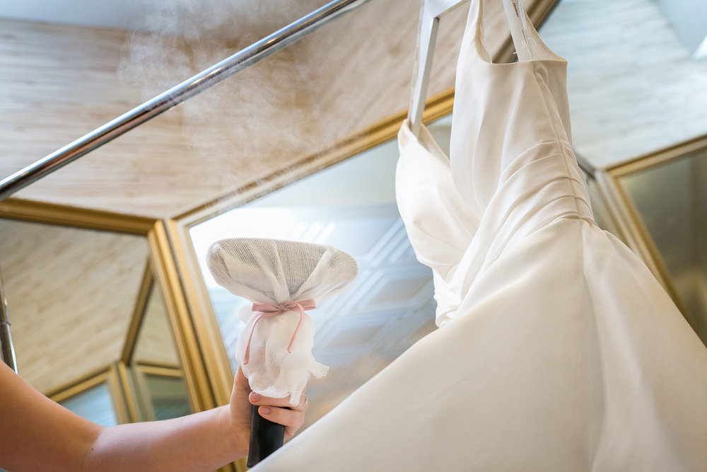 Whether your gown is purchased from BleuBelle or not, it is important that it looks its absolute best as you walk down the aisle. BleuBelle now offers in-store and on-site steaming to everyone.  Give us a call at 912.355.2502 to schedule your in-store steaming for your wedding gown or any additional dresses or tuxes needing attention before the big day.  We offer same day service ranging from $75 - $150 depending on the material, fullness and construction of your gown.  Bridesmaids dresses, mothers and tuxes start at $25.  We will confirm pricing upon drop off of gown. Flying in from out of town for your Savannah wedding or does your gown need a touch up the day of? We can come to you! Our on-site steaming fee is $100 in addition to the steaming service ranging from $75 - $150 for a wedding gown and $25 and up for maids dresses, mothers and tuxes.  Give us a call at 912.355.2502 for more information.