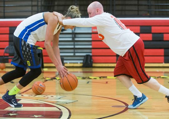 Elena Delle Donne works out Friday with her longtime personal coach, Ursuline coach John Noonan, at Ursuline Academy in Wilmington. (Photo: SUCHAT PEDERSON/THE NEWS JOURNAL)