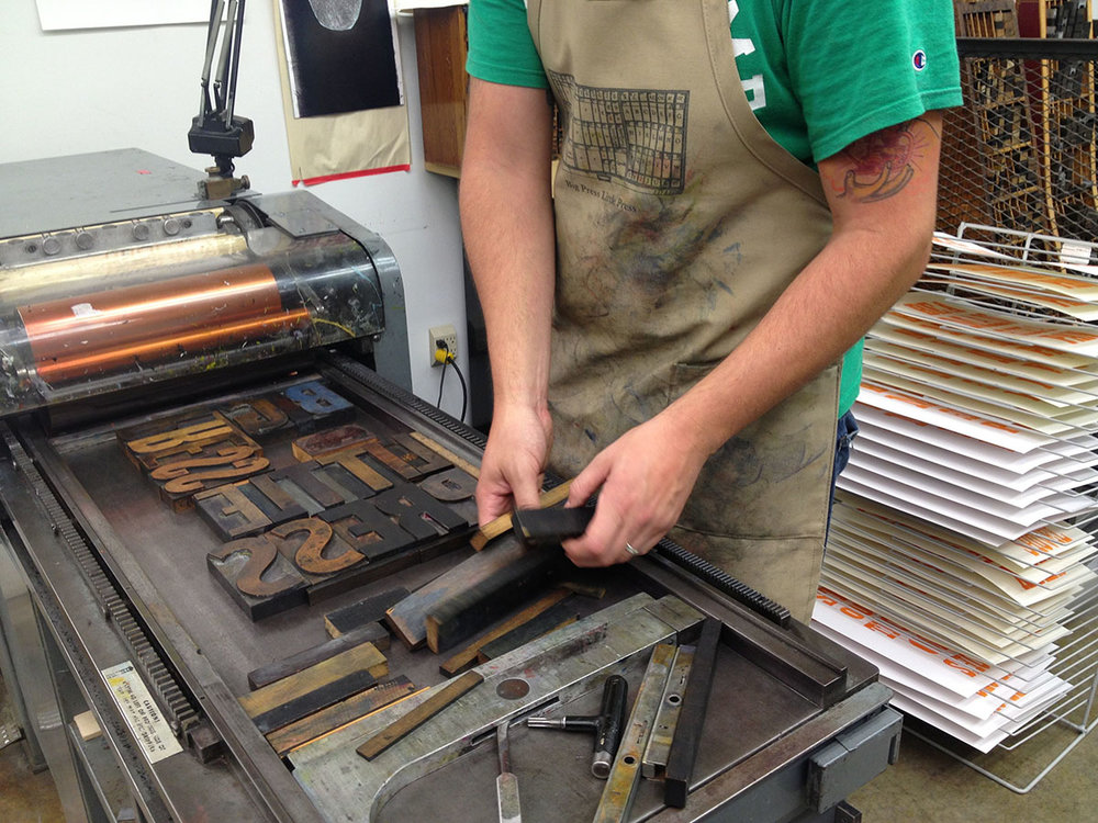"""Andy working on a """"Big Press Little Press"""" print."""