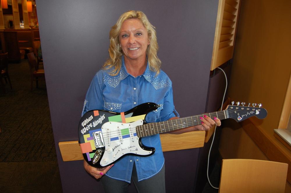 Debbie with guitar.JPG