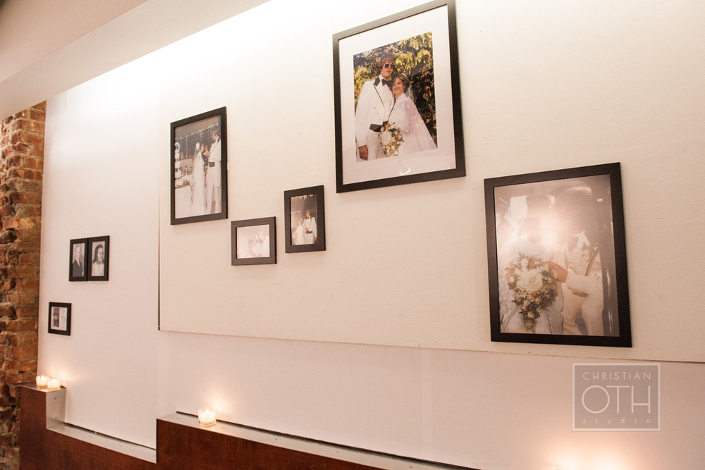 Photos of family members scanned, printed, and framed, are arranged in a gallery style along corridor to reception hall.   Photo: Sue Kessler of  Christian Oth Studio