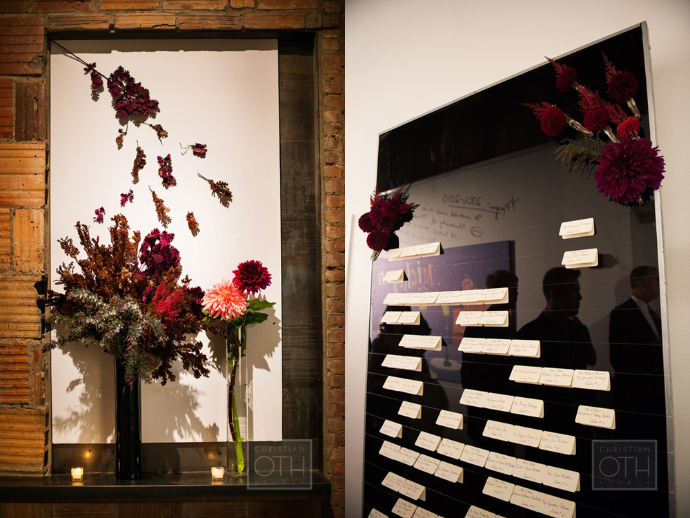 Whimsical floral design during cocktail hour.     Table cards hang from invisible wire tied to a tall black lucite board.   Photo: Sue Kessler of  Christian Oth Studio