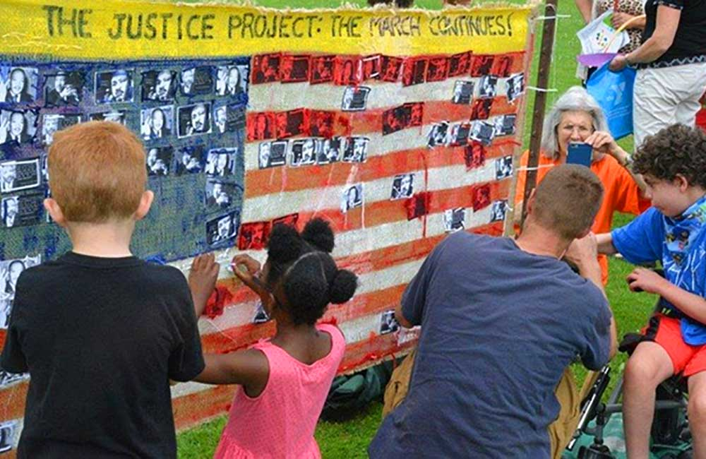 (2014 - Present)  Nearly 1,000 gathered at the Winnetka Village Green for      Justice Day     , a celebration of past achievement for social justice and ending discrimination in housing, and a call to action for a concerted effort to continue the fight against racism and work toward the dream of a Welcoming Community in Chicago's northern suburbs