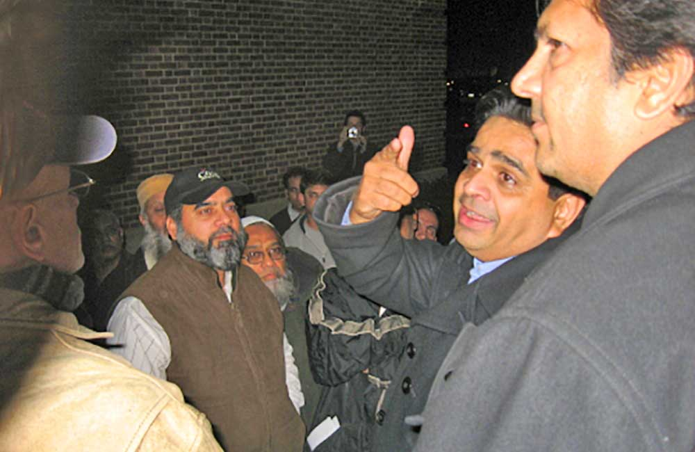 (2007 - 2008)   Skokie         taxicab         drivers celebrate outside the Village Hall after the Trustees unanimously voted to put on hold the implementation of a parking ban and work with drivers.