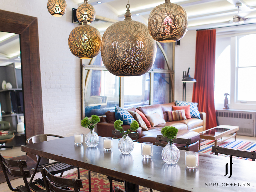 A Group Of Ornate Moroccan Chandeliers Hanging Above The Table Distinctly Identifies Dining Area